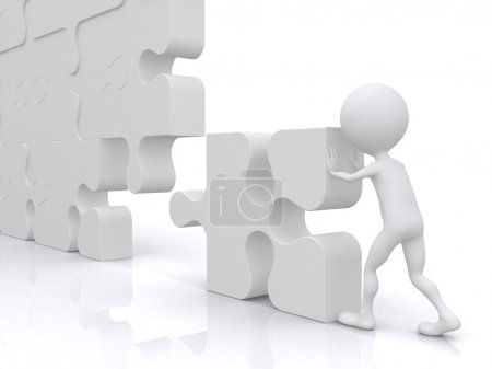 Business teamwork - business person building a puzzle which was