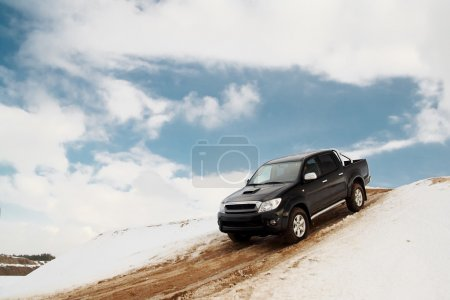 Pickup truck driving down the hill