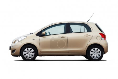 Beige compact hatchback isolated on white...