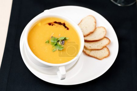 Photo for Puree of squash soup with smoked cheese and croutons - Royalty Free Image