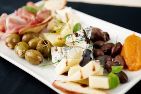 Photo for Snacks selection for wines (Parma ham, olives, cheese) - Royalty Free Image