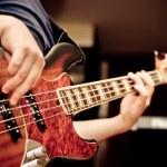 Musician playing a bass guitar...