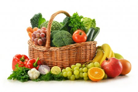 Photo for Composition with vegetables and fruits in wicker basket isolated on white - Royalty Free Image