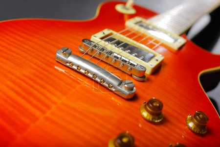 Close-up of red electric guitar