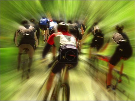 Photo for Mountain bike race in a forest in denmark, Shot with low shutter speed to achieve motion blur - Royalty Free Image
