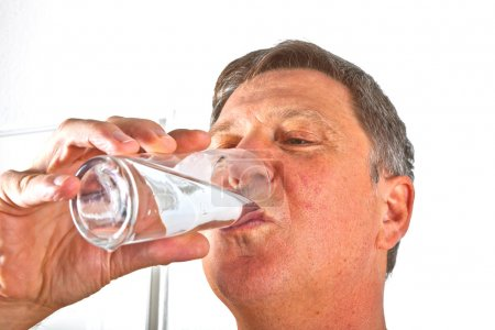 Portrait of attractive man drinking water