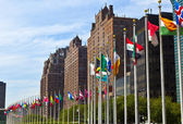 United Nations Headquarters with flags of the members of the U