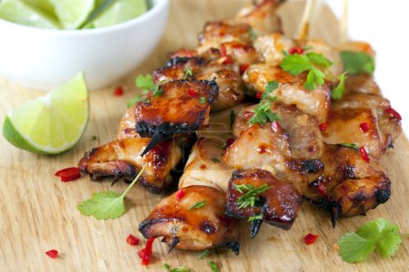 Photo for Thai chicken skewers marinated with chili, coriander or cilanto, and lime. - Royalty Free Image