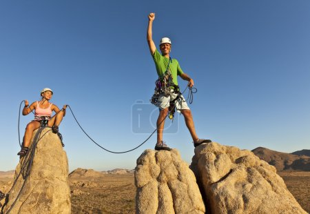 Photo for Team of rock climbers struggle to the summit of a challenging cliff. - Royalty Free Image
