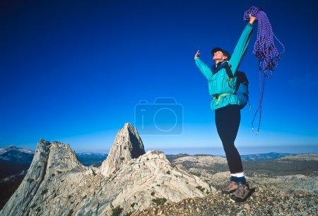 Female climber on the summit.