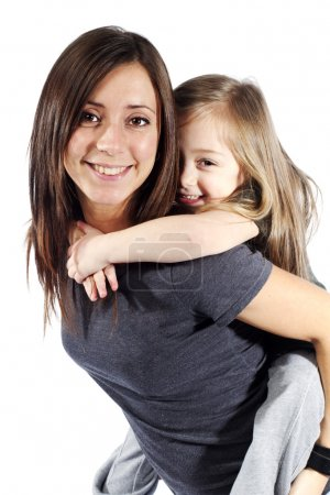 Mother giving her daughter a piggyback ride