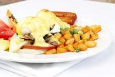 Mushroom ham and cheese eggs benedict