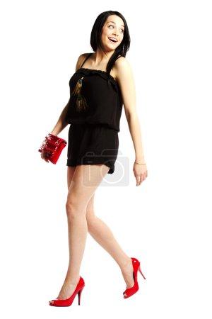 Young woman fashion model in heals struting her stuff