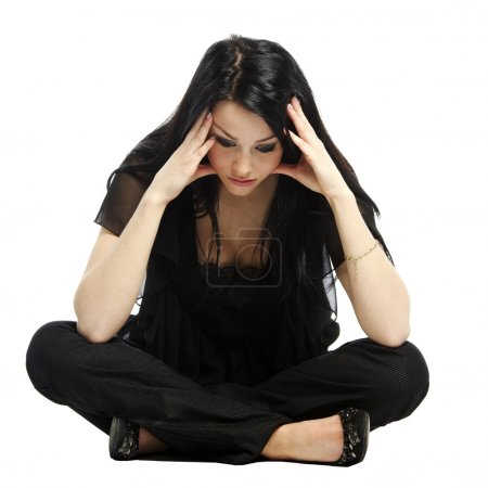 Photo for Young business casual woman worried with hands on head sitting - Royalty Free Image