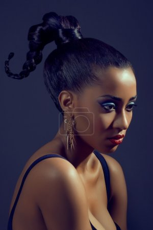Portrait of beautiful woman with stylish creative hairstyle