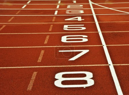Photo for Close up of athletics running track start and finish line with numbers from 1 to 8 - Royalty Free Image