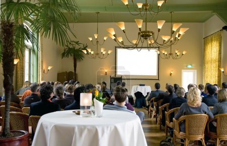 Photo for Audience at a conference in a classical surrounding - Royalty Free Image