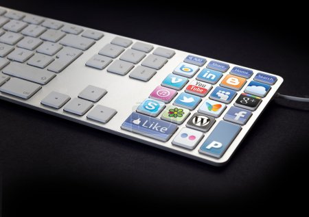Photo for Computer Keyboard with social media and network buttons on black background - Royalty Free Image