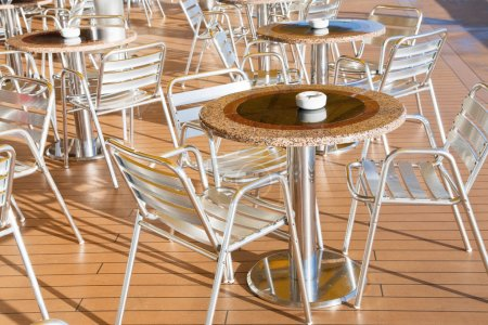 Tables with ashtrays in outdoor bar
