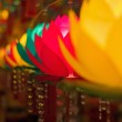 Colorful lotus shaped lamps in a buddhist temple...