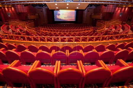 Photo for Back view of seats in auditorium with screen showing cruise Diamond Princess's promotional video. - Royalty Free Image