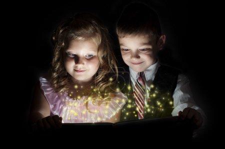 Boy and girl discover a magic book