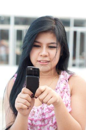 Cute asian young woman