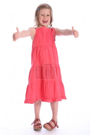 Six year old happy school girl success hand sign