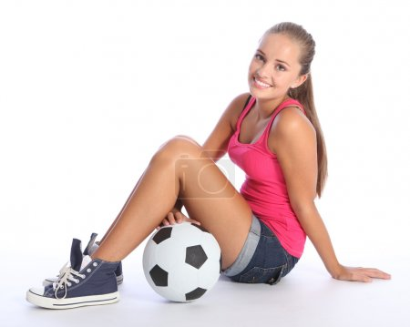 Beautiful teenage student girl with soccer ball