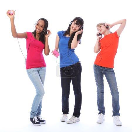 Teenage girls dancing fun to cell phone music
