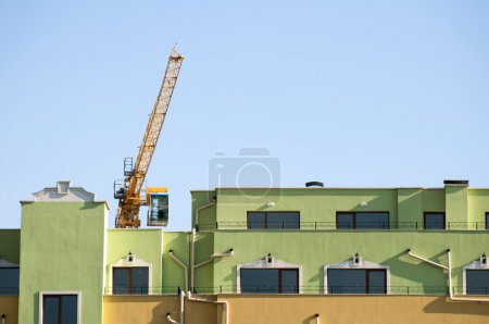New colored building and crane