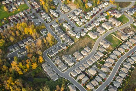 Photo for Aerial view of houses and suburban streets in autumn - Royalty Free Image