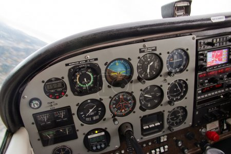 Pilot View of Complex Instrument Panel of Airplane