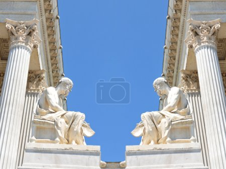 Photo for Beautiful classical theme with white marble Greek statues and columns against blue sky - Royalty Free Image