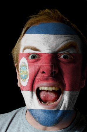 Face of crazy angry man painted in colors of costa rica flag