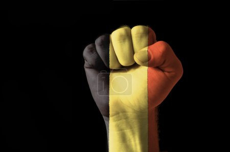 Fist painted in colors of belgium flag