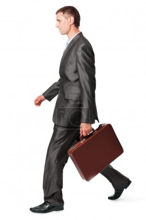 Businessman with case walking, isolated on white background