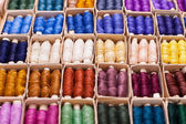Colored threads for sewing machine in box