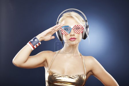 Beautiful girl in gold swimwear and American inspired accessorie