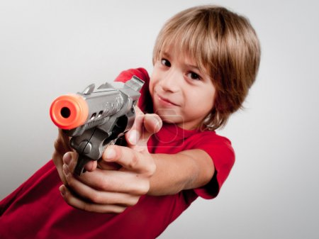 Boy with gun toy