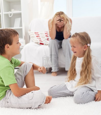Photo for Kids having a quarrel and fight - tough parenthood concept - Royalty Free Image