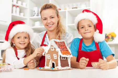 Happy christmas family in the kitchen