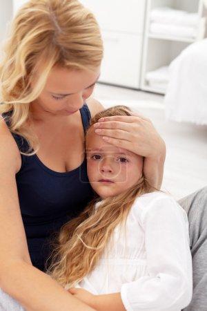 Mother comforting her upset kid