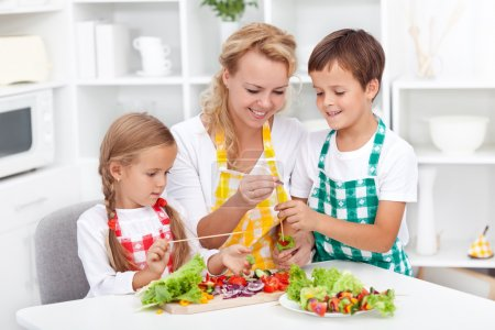Photo for Preparing fresh food with the kids - healthy eating education - Royalty Free Image