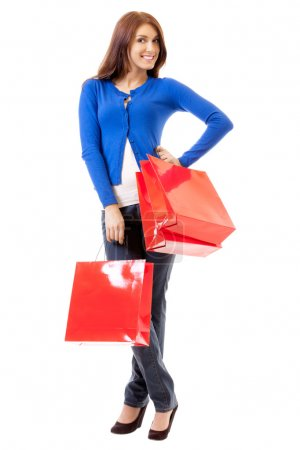 Young happy woman with shopping bags, isolated on white