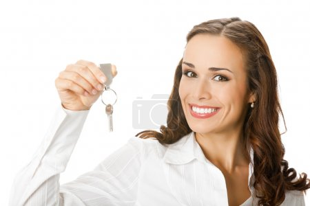 Woman or real estate agent showing keys, over white