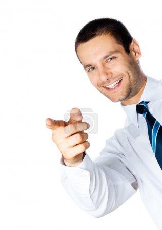 Photo pour Homme d'affaires souriant heureux pointant, isolé sur fond blanc - image libre de droit