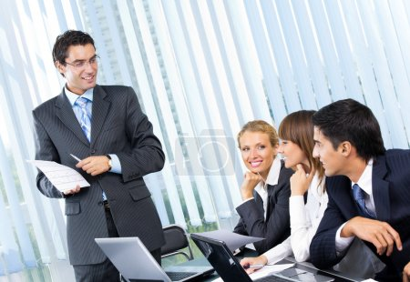 Businesspeople at business meeting, seminar or conference