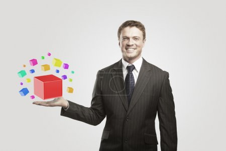 Young businessman with colored boxes.