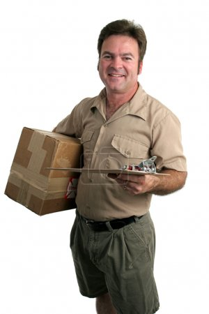 Photo for A delivery man with a package and a clipboard - isolated - Royalty Free Image